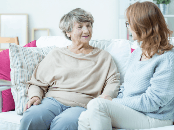 Elderly Woman Talking With A Younger Woman In Living Room