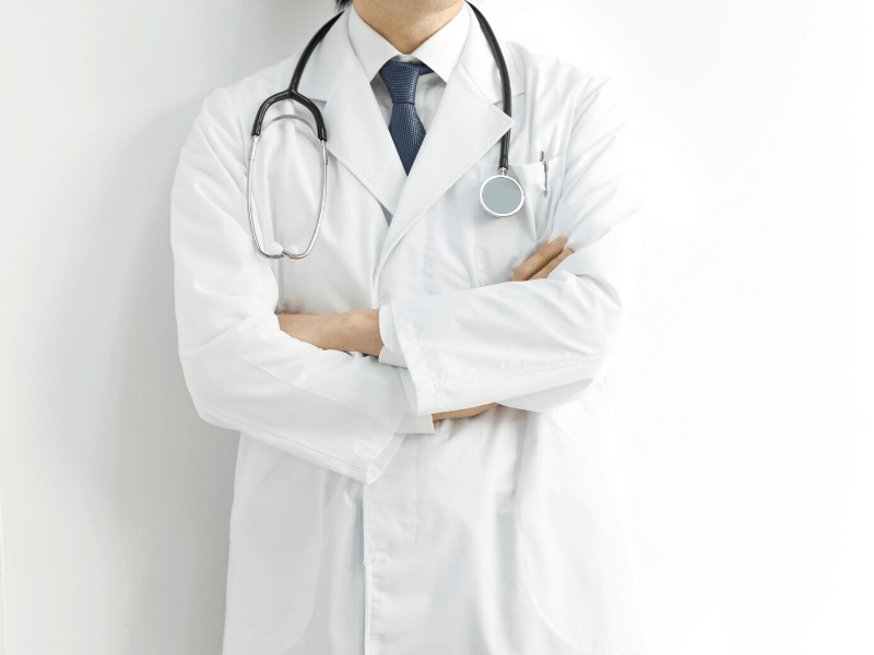 doctor standing against wall